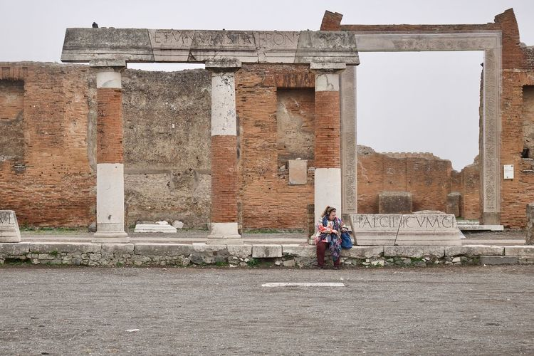 Pause in Pompei Adult Adults Only Architecture Building Exterior Built Structure Day Full Length Leisure Activity Lifestyles Men One Person Only Women Outdoors People Pompeii  Pompeji Sky Travel Destinations Women Young Adult Young Women