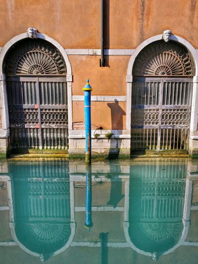 Venezia Venice Italy Travel Photography Travel Traveling Mobile Photography Fine Art Architecture Architectural Heritage Historical Buildings Twin Doors Grids Canals Lagoon Water Reflections And Shadows Simmetry Learn & Shoot: Balancing Elements Mobile Editing