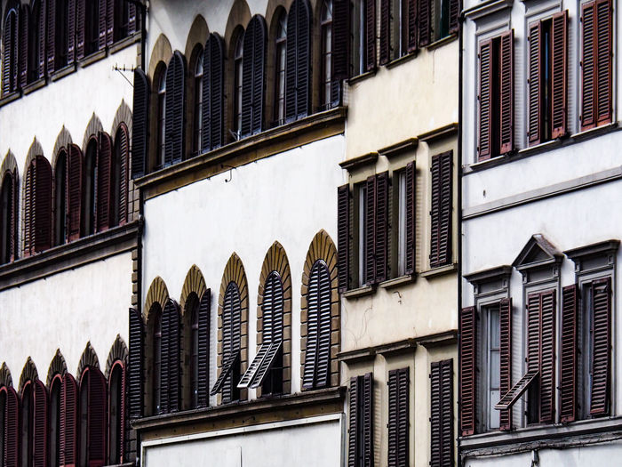 Architecture Building Exterior Built Structure Building Low Angle View Window No People Day Arch Residential District Outdoors City In A Row Pattern Full Frame Travel Destinations Repetition Sunlight Nature House Firenze