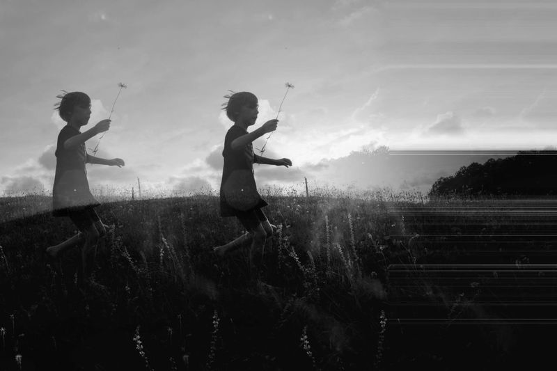 Multiple image of boy running on field against sky