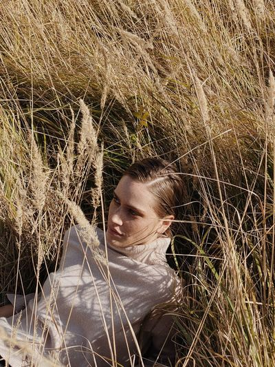 Portrait of woman relaxing on grass