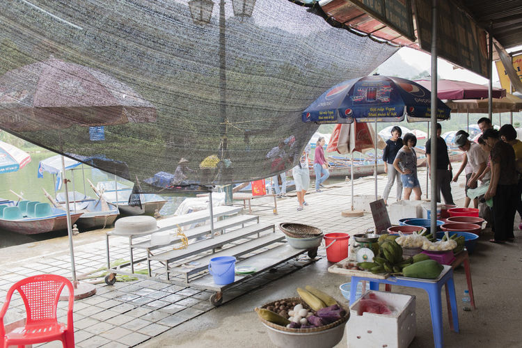 Vietnam, Hanoi - October 21, 2016: Vietnamese street vendors act and sell their vegetables and fruit products in Hanoi, Vietnam ASIA Baskets Centrally Vietnam Hanoi, Vietnam Huế Tourist Trip Vegetable Market Vietnam Vietnamese Vietnamese Population Concept Culture Editorial  Fruit Hanoi Hanoi Vietnam  Imperial City Perfume River  Scene Sell Street Shop Assistants Trade Vacation Vegetables