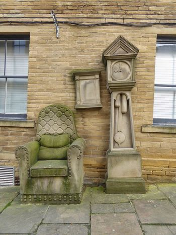 Bradford Little Germany, Bradford Grandfather Clock Grandfather Clock And Chair Timothy Shutter Sandstone Sculpture 1992 Mill Owner's Office Yorkshire Sculpture