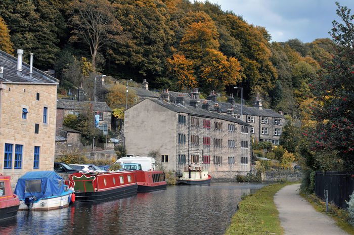 canal and houseboats in hebden bridge Hebden Bridge Architecture Autumn Barges Building Exterior Built Structure Day Mode Of Transport Moored Nature Nautical Vessel Outdoors River Sky Transportation Tree Water Waterfront