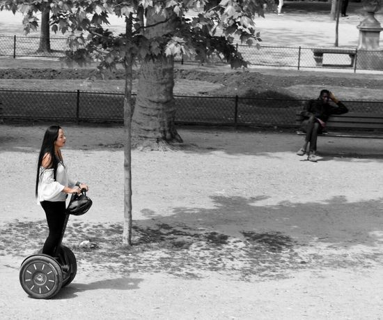 Full Length Only Women One Person Leisure Activity Adult Lifestyles Day Women One Woman Only People Real People Outdoors Tree Motion Healthy Lifestyle Young Adult One Young Woman Only City Segway Colorsplash BYOPaper! Paris