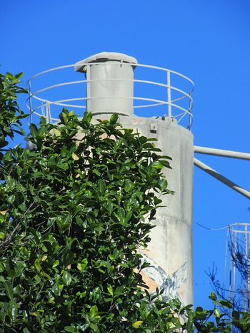 Tree Clear Sky Water Tower - Storage Tank Factory Industry Fuel And Power Generation Blue Storage Tank Power Station Sky Irrigation Equipment Creeper Lighthouse Razor Wire Water Tank Silo Creeper Plant Barbed Wire Storage Fuel Storage Tank Growing Water Pump Sprinkler Ivy Agricultural Equipment Groyne Hydroelectric Power Water Conservation Sharp Petrochemical Plant