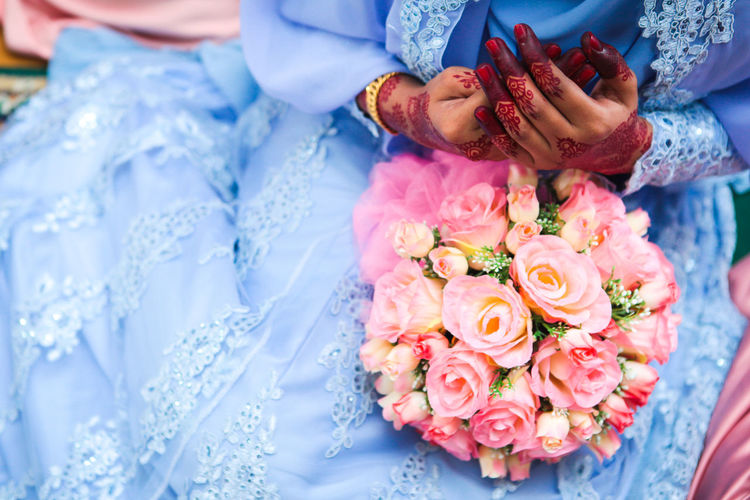 High angle view of bride with rose bouquet