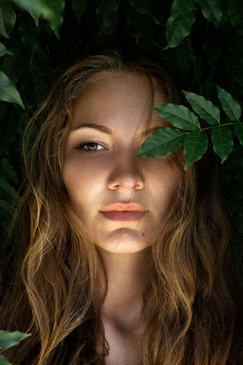 Beautiful Woman Beauty Close-up Front View Leaf Long Hair Nature One Person One Young Woman Only Outdoors Portrait The Portraitist - 2017 EyeEm Awards Young Adult Young Women