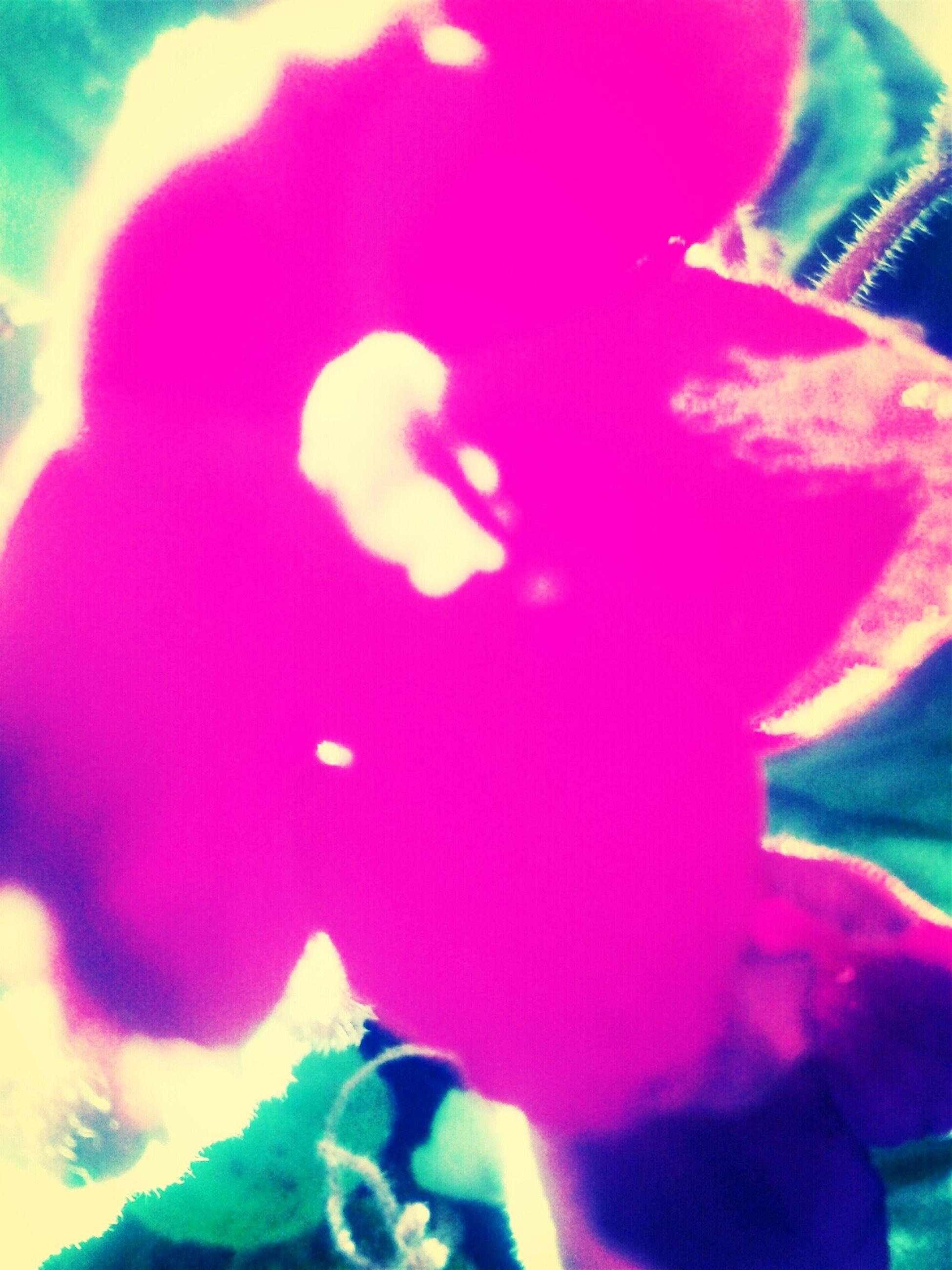 indoors, lifestyles, leisure activity, arts culture and entertainment, illuminated, celebration, men, enjoyment, person, purple, close-up, fun, multi colored, pink color, childhood, light - natural phenomenon, headshot