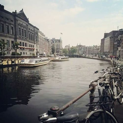 CyclingUnites Amsterdam Canal Travel Travel Destinations Bicycle City Water Clear Sky Outdoors