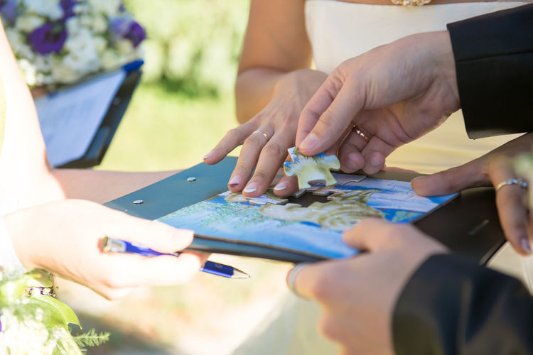 Cropped Image Of Bride And Groom Playing Puzzle