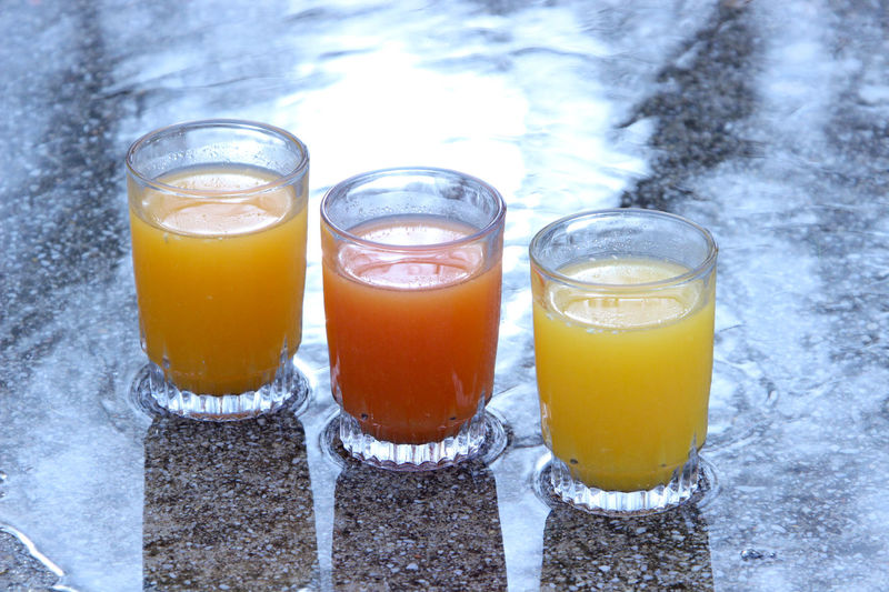 3 Glasses Day Freshness Juice No People Orange Color Orange Juice  Outdoors Refreshment Side By Side Still Life Yellow