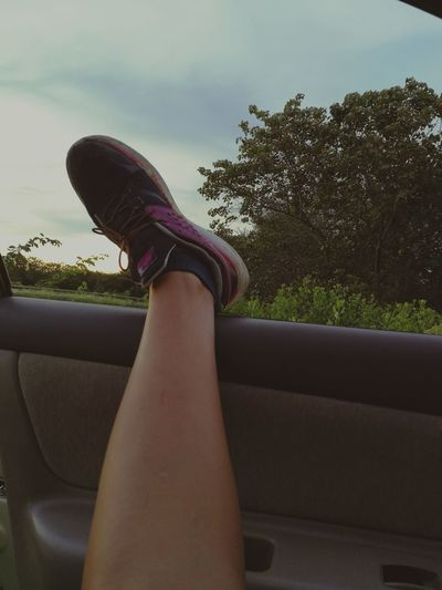 Low section of woman legs in car