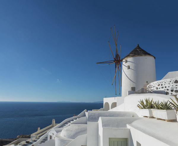 Iconic Windmills Of Santorini Caldera Greek Mediterranean  Architecture Blue Building Built Structure Clear Sky Greece Horizon Horizon Over Water Nature No People Oia Outdoors Santorini Scenics - Nature Sea Sky Water
