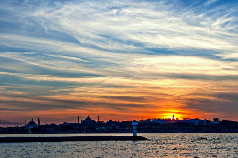 Sunset in Istanbul, from a ferry crossing Bosphorus. The Tourist Clouds Clouds And Sky over Marmara Sea in Istanbul Turkey City Travel Photography Sunset Sunsetoversea Sunsetovercity Sunsetoverwater Nature Sunset Silhouettes Bluesky Orangesky Blue Sky Orange Sky First Eyeem Photo Showcase: February Whitewall