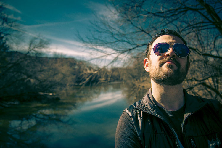 Man wearing sunglasses in lake