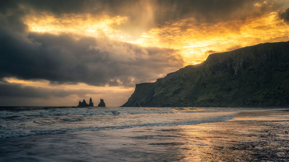 Reynisdrangar sea-stacks, southern coast of Iceland Iceland Basalt Basalt Columns Beach Beauty In Nature Cloud - Sky Horizon Horizon Over Water Idyllic Land Motion Nature No People Outdoors Power In Nature Reynisdrangar Rock Scenics - Nature Sea Sea-stack Sky Sunset Tranquil Scene Tranquility Water