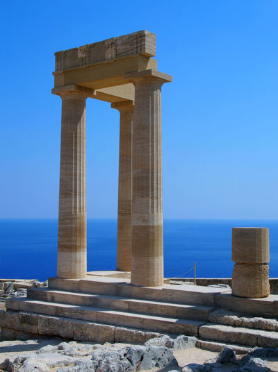 the acropolis in lindos rhodes Acropolis Acropolis Lindos Ancient Greece Architectural Column Architecture Blue Built Structure Clear Sky Columns Day Doric Order History Horizon Over Water Nature No People Old Ruin Outdoors Sea Sky Travel Destinations Water