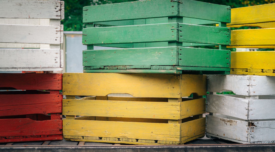 wooden boxes Farm Farmland APIculture Box Box - Container Close-up Container Day Insect Multi Colored No People Outdoors Stack Wood - Material Yellow