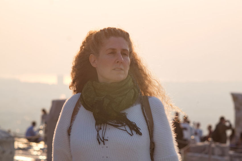 Raphaela Gilla in the sunset One Person Hairstyle Portrait Water Front View Focus On Foreground Leisure Activity Long Hair Sky Hair Young Adult Sunlight Beach Headshot Standing Sea Nature Looking Sunset Contemplation Beautiful Woman
