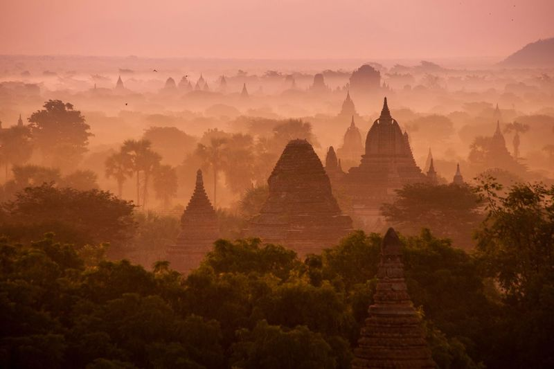 Sunrise in Bagan - Myanmar 🇲🇲 2018 Travel Destinations Travel Buddhism Backgrounds Orange Fog Mist Sunrise Heritage History Place Of Worship Architecture Religion Travel Travel Destinations Fog Pagoda Ancient Environment Tourism Scenics - Nature Ancient Civilization No People