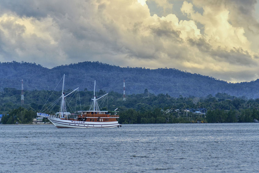 Berth Boat Cloud Cloud - Sky Cloudy EyeEm Gallery Journey Nature Nautical Vessel Outdoors Phinisi Boat Sea Sea And Sky Seascape Sky Sunset Tranquil Scene Tranquility Transportation Trip Voyage Water Waterfront Kendari Bay