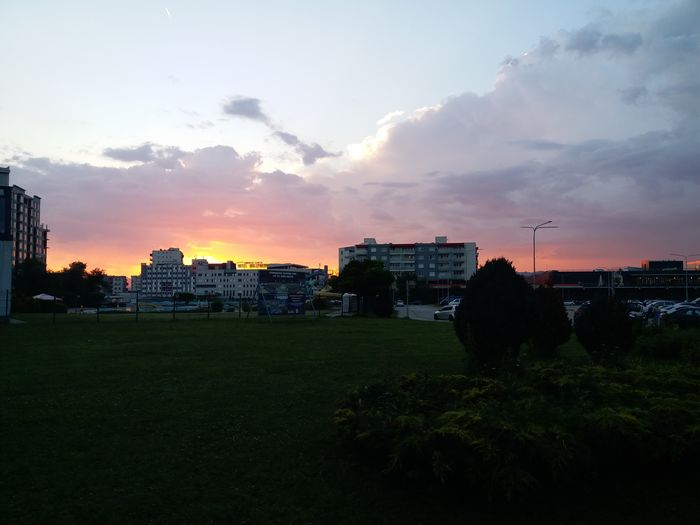 Buildings against sky during sunset