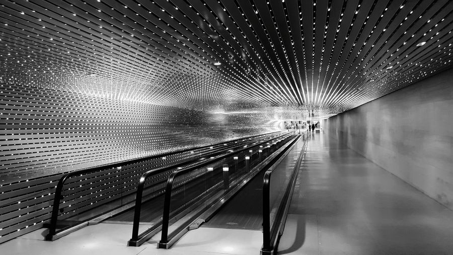 A black and white version Washington, D. C. National Gallery Of Art Tunnel Patterns Lines Lights Vanishing Point Blackandwhite Photography No People Architecture Day Built Structure Outdoors AI Now Mobility In Mega Cities