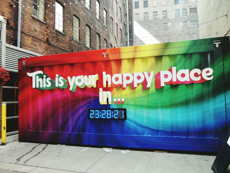 Happy Nice Good Goodplace Future Modernity Modern Let's See Your Colors! Colors Color Colorful Times Time Clock Joy #free USA America Wecandoit Yes Wonderful Day No People Architecture Western Script Text Built Structure Building Exterior Graffiti Communication