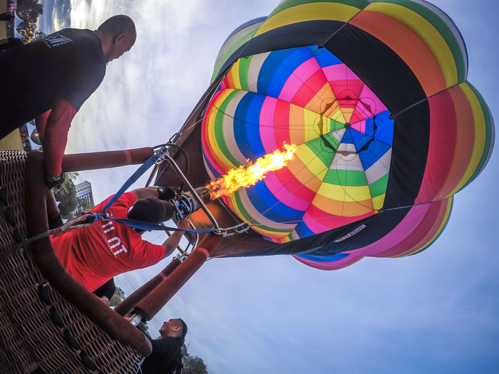 Adult Adventure Arts Culture And Entertainment Balloon Day Enjoyment Fun Group Of People Leisure Activity Lifestyles Low Angle View Men Multi Colored Nature Outdoors People Real People Sky