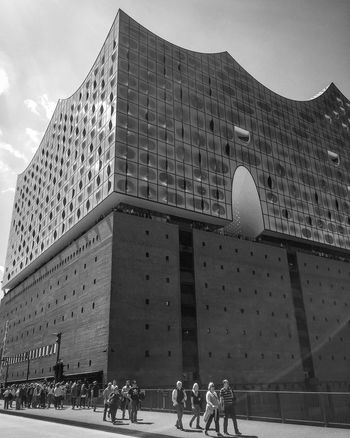 Architecture Built Structure Building Exterior Real People City Sky Large Group Of People Day Travel Destinations Low Angle View Outdoors Light And Shadow Tourism Travel City Hamburg Elbphilharmonie Low Angle View Street Photography Monochrome Bnw Black & White Blackandwhite Photography Black And White Modern Architecture