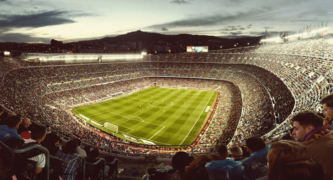 sport, stadium, large group of people, crowd, playing, outdoors, soccer, team sport, leisure activity, spectator, real people, sports team, fan - enthusiast, men, sky, audience, day, people