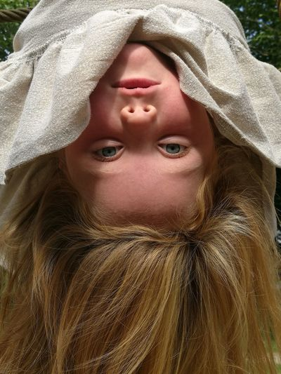 Upside Down One Person Hanging Human Face Portrait Hair Looking At Camera Girl The Week On EyeEm Piercing Eyes Child Childhood Hanging Out EyeEm Ready   Inner Power