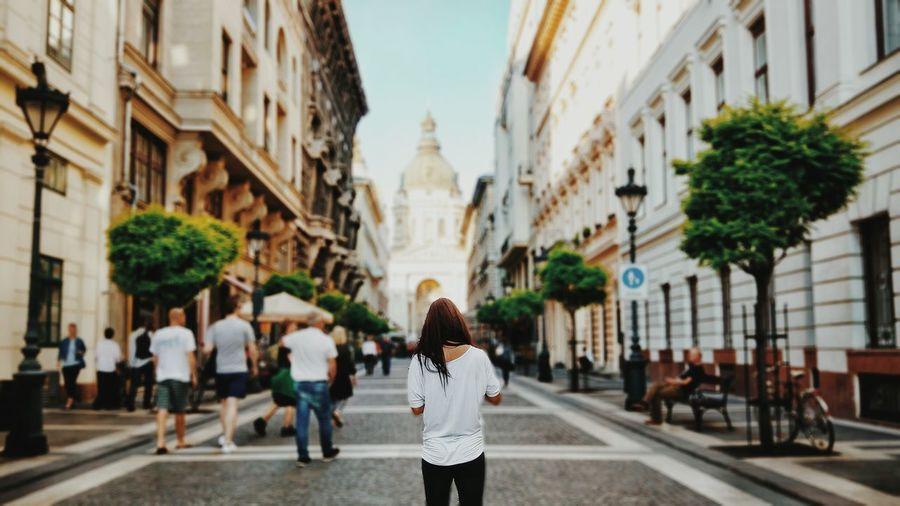 People walking in front of buildings