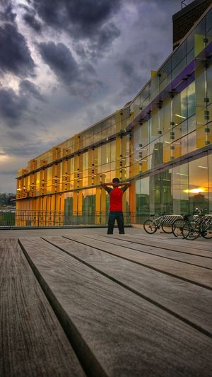 Looking the sunset One Man Only One Person Men Architecture Sunset Only Men Full Length People Adult City Outdoors Night First Eyeem Photo