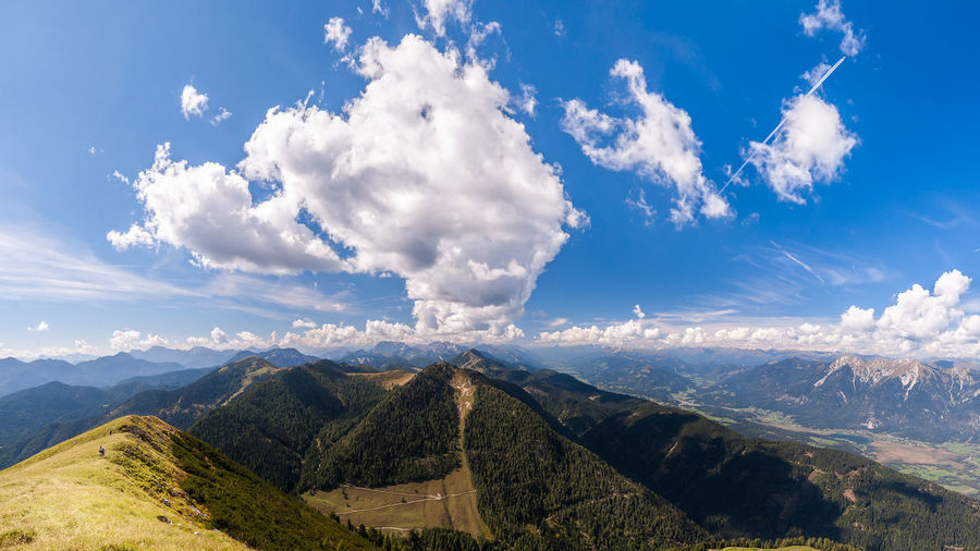 Beautiful mountain panorama on Italian Alps with blue sky and clouds. Scenics - Nature Cloud - Sky Sky Beauty In Nature Mountain Tranquil Scene Tranquility Environment Landscape Non-urban Scene Mountain Range Nature Day No People Idyllic Outdoors Blue Plant Sunlight Land Mountain Peak