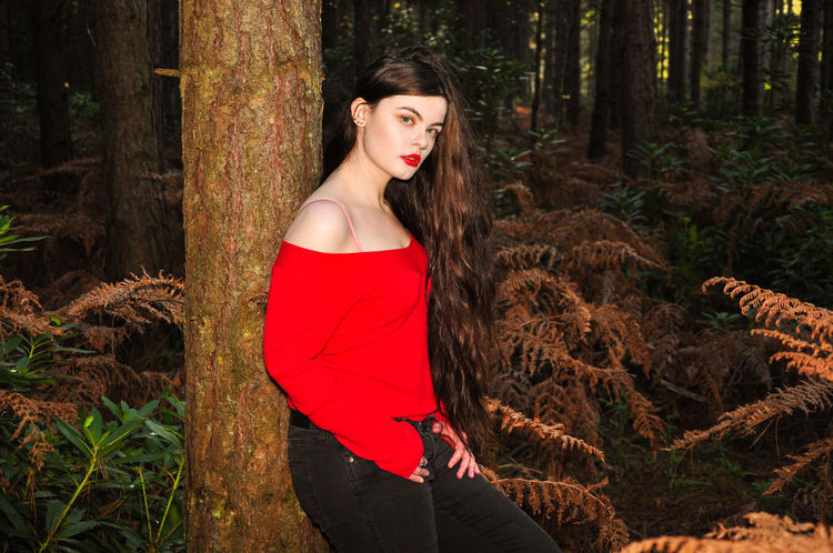 Beautiful young lady in a red jumper in a forest in the autumn Girl Millenial Young Lady Red Red Color Red Lipstick Forest Trees Beauty Beautiful Woman Beautiful Long Hair Portrait Portrait Of A Woman Portrait Photography Tree Trunk Red Jumper Off The Shoulder Stunner Beautiful Young Lady Beautiful Young Woman Autumn Autumn colors autumn mood One Person Tree Three Quarter Length Young Adult Trunk Standing Young Women Nature Real People Hair Fashion Outdoors WoodLand