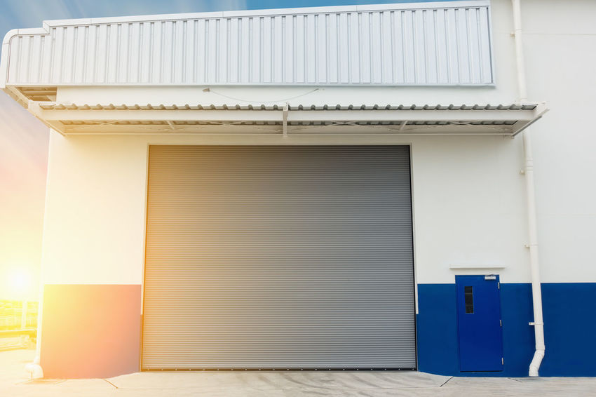 Warehouse shutter door Business Canopy Entrance Gate Industrial Industry Plant Security Workshop Architecture Building Building Exterior Built Structure Design Door Downspout Drainage Factory Building Flare Floor Outdoors Roofing Shutter Door Sky Steel Warehouse First Eyeem Photo