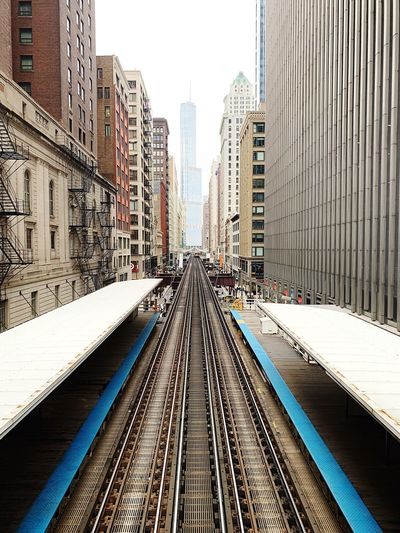 Architecture Building Exterior Built Structure Track Railroad Track Transportation Rail Transportation The Way Forward Day Tall - High Nature Mode Of Transportation Skyscraper Diminishing Perspective Office Building Exterior Public Transportation City Building Direction Modern