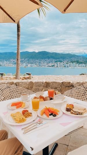 High angle view of breakfast on table at beach