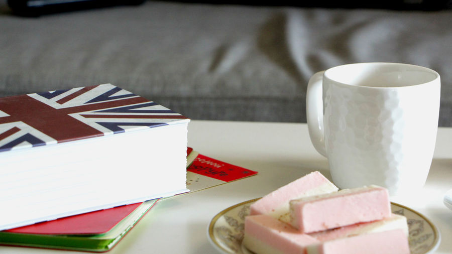 Close-up of food and drink by book on table