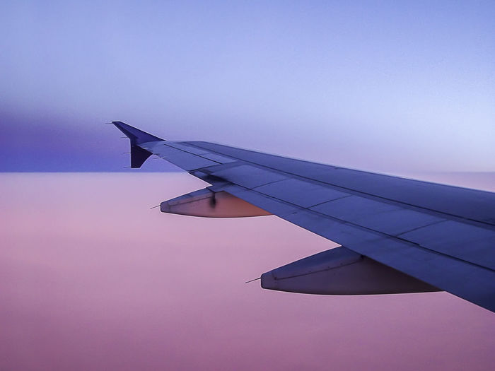 Aircraft Wing Beauty In Nature Blue Jet Pink Scenics Sky Sunset