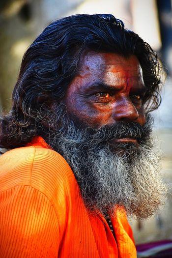 Close-up of sadhu looking away