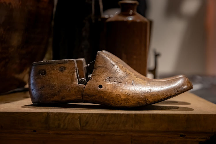 Close-up of wooden shoe on table