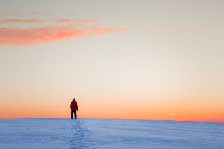 Just me exploring places Sky Sunset Beauty In Nature Scenics - Nature Orange Color Real People Horizon Lifestyles Standing One Person Outdoors Winter Cold Temperature Freeze Alone Explore Hike Backgrounds Copy Space Silhouette Nature Minimal