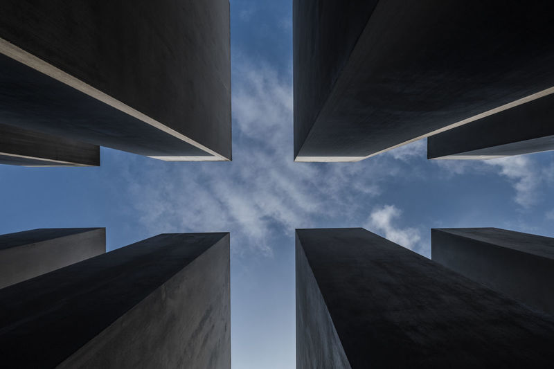 low angle view of Holocaust Memorial in the City of Berlin with Abstract pattern and blue sky background 2nd World War Second World War Memorial Abstract Pattern Architecture Blue Sky With Clouds Building Building Exterior Built Structure City Cloud - Sky Concrete Day Directly Below Holocaust Memorial Berlin Jewish Memorial Low Angle View Modern Nature No People Office Outdoors Pattern Reflection Shape Sky Skyscraper Tall - High