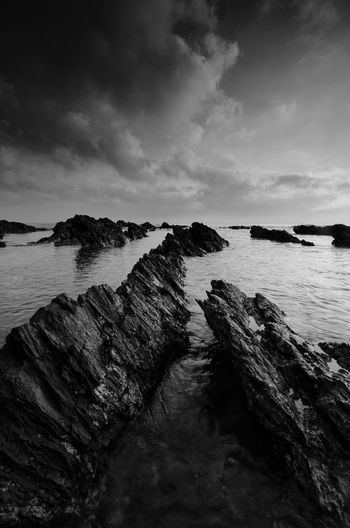Amazing rock formations at Pandak beach, Terengganu in black and white monochrome fine art technique.  Nature composition blur soft focus noise visible due to long exposure effect. Fine Art Black And White Landscape Amazing View Amazing Black&white Fine Art Photography Terengganu Malaysia Wallpaper EyeEm Nature Lover EyeEm Backgrounds Blackandwhite Sunrise Kelantan Sunset Water Nautical Vessel Sea UnderSea Beach Sky Horizon Over Water Cloud - Sky Wave Seascape Scenics