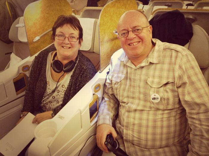 Upgraded business class. We did not mind the two hour delay on board to Cochin....