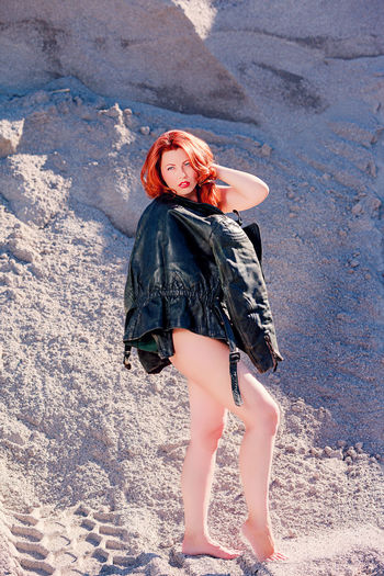 Redhead young woman standing outdoors