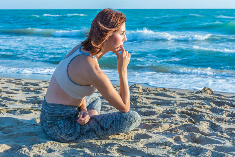 Yoga Yoga Pose Yogagirl Yoga ॐ Yoga Practice Beach Sea Land Water Leisure Activity Lifestyles One Person Women Full Length Sand Hairstyle Real People Adult Nature Hair Sitting Beauty In Nature Beautiful Woman Outdoors